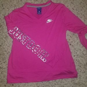 Nike pink small long sleeve t iridescent symbols